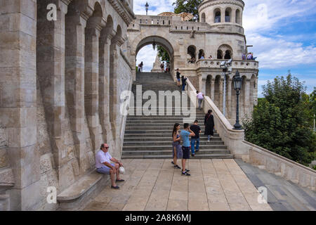 Budapest, Hungary - August 8, 2019: Tourists are visiting the Fisherman's Bastion on the Castle Hill in Budapest, Hungary - Stock Photo