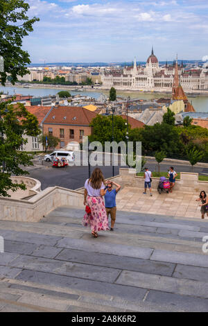 Budapest, Hungary - August 8, 2019: Cityscape view with famous Parliament Building from the Fishermen's Bastion on the Castle Hill - Stock Photo