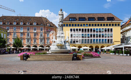 BOLZANO, ITALY - JULY 20, 2019 -  Considered the living room of Bolzano, Piazza Walther von der Vogelweide is the main square of the city - Stock Photo