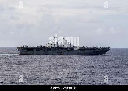 191105-N-NB544-1054 PACIFIC OCEAN (Nov. 5, 2019) The amphibious assault ship USS Boxer (LHD 4) transits the Pacific Ocean. The Boxer is part of the Boxer Amphibious Ready Group (ARG) and 11th Marine Expeditionary Unit (MEU) team and is deployed to the U.S. 7th Fleet area of operations to support regional stability, reassure partners and allies, and maintain a presence postured to respond to any crisis ranging from humanitarian assistance to contingency operations. (U.S. Navy photo by Mass Communication Specialist 2nd Class Kyle Carlstrom) - Stock Photo