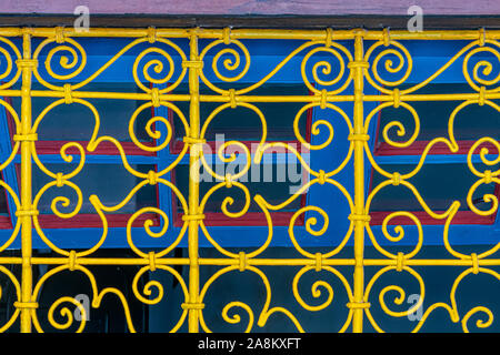 Detail of yellow decorative fence of a window of the Bahia palace in Marrakech. Morocco - Stock Photo