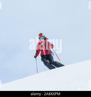female skier skiing in high alpine landscape near Zermatt in Monte Rosa region - Stock Photo