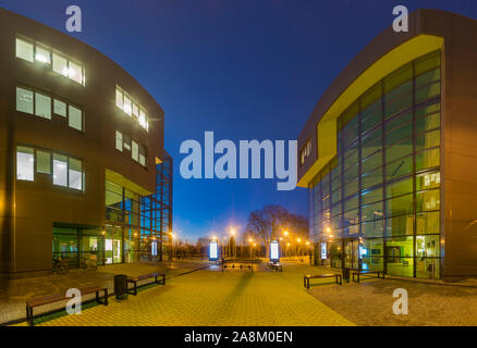 Modern office building in the evening - Stock Photo