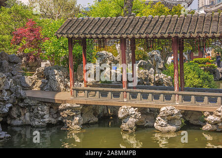 Editorial: SHANGHAI, CHINA, April 18, 2019 - Covered bridge over a pond in the Yuyuan Garden in Shanghai - Stock Photo