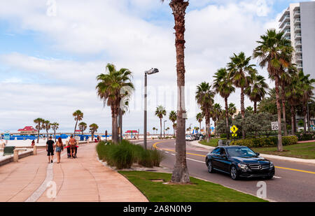 The walkway along South Guldview Blvd on a partly sunny fall day, Clearwater Beach, Florida, USA - Stock Photo
