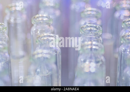Medical empty glass bottles in showcase at pharmaceutical exhibition - Stock Photo