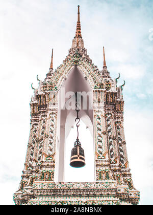 Ring bells in temple. Golden metal bell isolated. Big brass Buddhist bell of Japanese temple. Ringing bell in temple is belief auspicious. Wat pho Ban