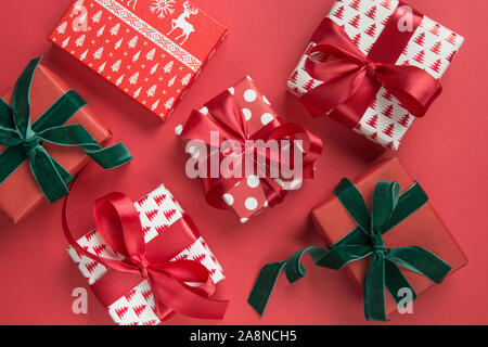 Christmas composition of holiday gifts on red background. Boxing day. Greeting card. Winter. Happy New Year. . View from above, flat lay. Template, mo - Stock Photo