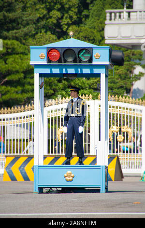 Seoul, South Korea. October 2012: Police guard the entrance to the President's residence also known as the Blue House - Stock Photo
