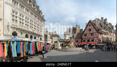 Dijon, Burgundy / France - 27 August 2019: market day on the Francois Rude Square in the historic old city center of Dijon - Stock Photo