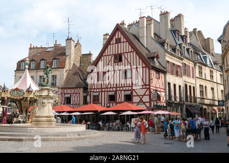 Dijon, Burgundy / France - 27 August 2019: many tourists visiting the Francois Rude Square in the historic old city center of Dijon - Stock Photo