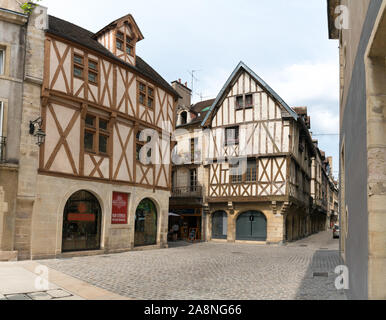 Dijon, Burgundy / France - 27 August 2019: a detail view of the narrow streets and historic half-timbered houses in the old city center of Dijon in Bu - Stock Photo