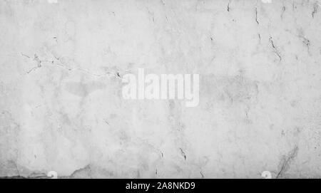 Close-up of an aged and cracked smooth natural marble stone wall or flooring. High resolution full frame textured background in black and white. - Stock Photo