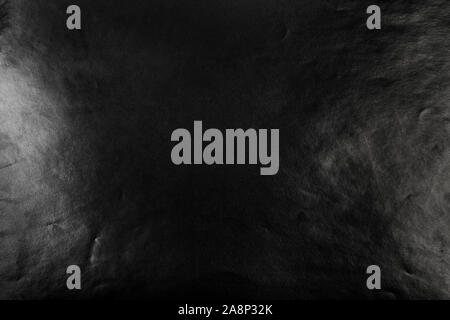 Black wrinkled paper texture with flare for design. Abstract dark background - Stock Photo
