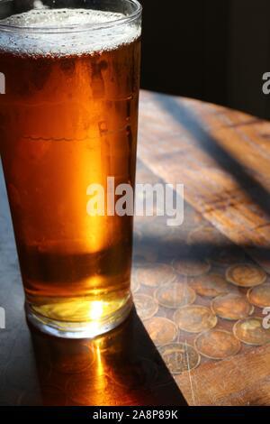 beer glass back light  in sunshine - Stock Photo