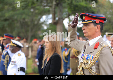 Brig. Mark Thornhill CBE, British (right) salutes during the commemoration ceremony of World War Veterans held at the Commonwealth War Graves Cemetery that was opened in 1941 by the military authorities. It contains 1,952 Commonwealth burials of the Second World War, 11 of which are unidentified. Nairobi was the headquarters of the East African Force. - Stock Photo