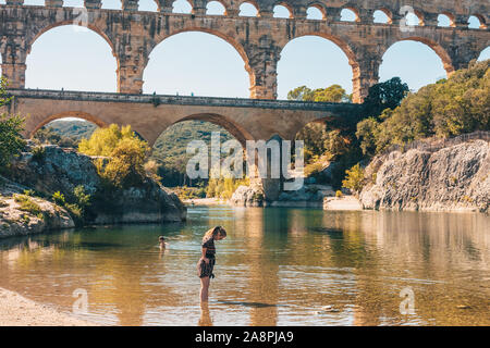 Vers-Pont-du-Gard, Gard / Occitanie / France - September 26, 2018: Idyllic picture of people on the background of a calm river - hiking - Stock Photo