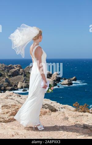 Bride on Cliff - Stock Photo