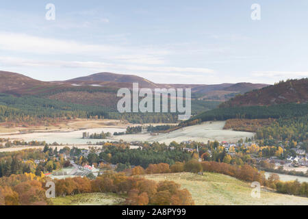 The Village of Braemar Alongside the River Dee and Surrounded by Mountains on an Autumn Morning in the Cairngorms National Park in Scotland - Stock Photo