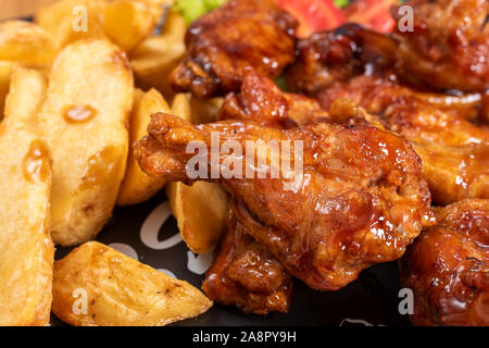 Chicken wings in sweet and sour sauce. - Stock Photo