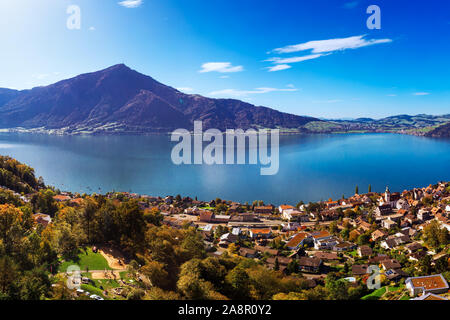 Aerial view of Walchwil town with colorful trees, Zugersee and Rigi mountain, Zug, Switzerland, Europe. - Stock Photo