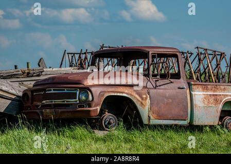 Old abandoned truck in junk yard on the prairies in Saskatchewan - Stock Photo