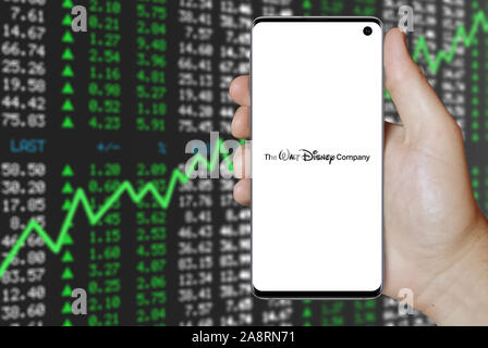 Logo of public company The Walt Disney Company displayed on a smartphone. Positive stock market background. Credit: PIXDUCE - Stock Photo