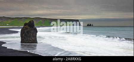 ICELAND LANDSCAPE: Reynisfjara Beach view point Dyrholaey. Famous Iceland black sand beach on South Iceland. Icelandic nature landscape tourist attraction destination.