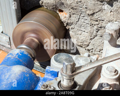 Device for drilling large diameter holes in operation - Stock Photo