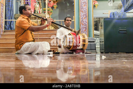 PUDUCHERRY (PONDICHERRY)/INDIA-FEBRUARY 24 2018:usicians play traditional music amongst visitors and devotees inside Manakula Vinayagar Temple. - Stock Photo