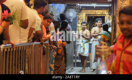 PUDUCHERRY (PONDICHERRY)/INDIA-FEBRUARY 24 2018:Worshipers queue up inside Manakula Vinayagar Temple to recieve blessings and give gifts at a holy shr - Stock Photo