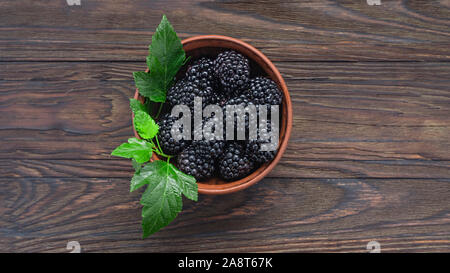 ripe raspberries, raspberries strawberries, blueberries blackberries, currants raspberries, wooden background, copy space - Stock Photo