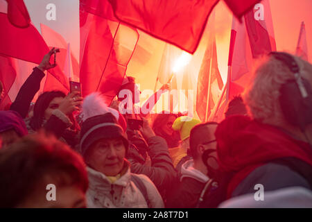 Warsaw / Poland - 11.11.2018: The Independece March. nationalists faces flags and symbols. National independence day, 100th anniversary. - Stock Photo