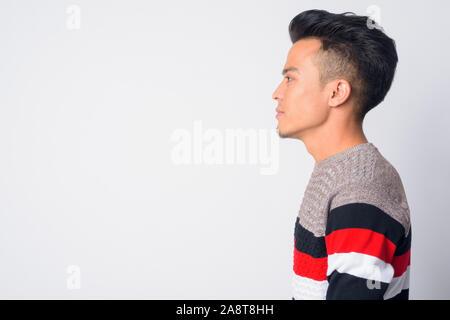 Closeup profile view of young Asian man - Stock Photo