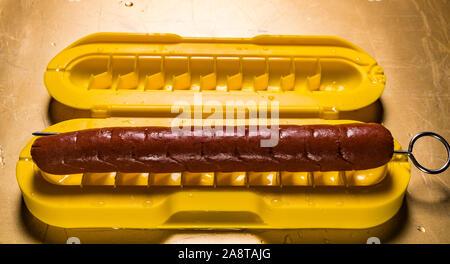 Curl A Dog Spiral Hotdog Slicer with hotdog - Stock Photo