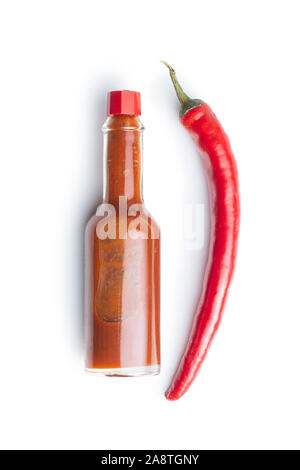 Red chili pepper and tabasco sauce isolated on white background. - Stock Photo