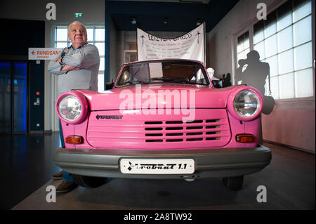 83 year Roland Schulze who worked on the production of the East German Trabant. Stands beside the last Trabant to ever come off the production line- - Stock Photo