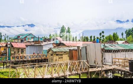 Dal lake in Srinagar city. Shikara boats on the water, everyday life on Dal lake, Srinagar, Jammu and Kashmir, India - Stock Photo