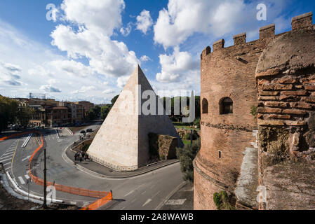 Rome. Italy. View of  the Piramide di Cestio (Pyramid of Cestius, built ca. 18–12 BC), tomb of Gaius Cestius, magistrate and member of the Septemviri - Stock Photo
