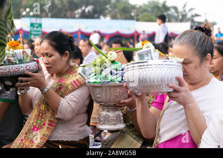 Vientiane, Laos. 11th Nov, 2019. People attend the almsgiving activity around the That Luang Stupa in Vientiane, Laos, Nov. 11, 2019. Considered as the most important religious festival in Laos, the That Luang Festival, which falls from Nov. 5 to Nov. 11 this year, concluded on Monday with a mass almsgiving activity held in and around the That Luang Stupa in Vientiane. Credit: Kaikeo Saiyasane/Xinhua/Alamy Live News - Stock Photo