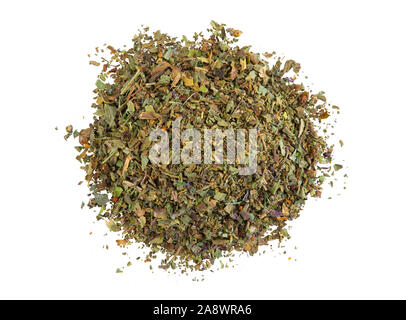 Pile of a dry, chopped, mixed herbs isolated on white background with copy space for text or images. Spices. Food, cooking, restaurant, packaging conc - Stock Photo