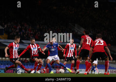 Emyr Huws of Ipswich Town surrounded by Lincoln City players - Ipswich Town v Lincoln City, The Emirates FA Cup first round, Portman Road, Ipswich, UK - 9th November 2019  Editorial Use Only - DataCo restrictions apply - Stock Photo