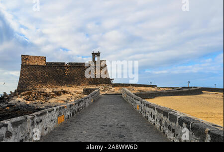 View of The fortress Castillo de San Gabriel (Castle of San Gabriel ) situated at small island in front of the Arrecife,capital of Lanzarote, Canary I - Stock Photo