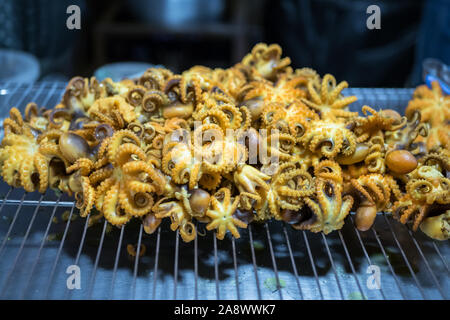 Close-up view of the fried octopus as snack street food in Bangkok,Thailand. - Stock Photo