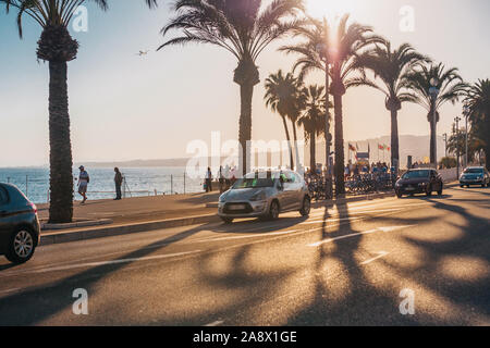 Nice, Provence / France - September 28, 2018: Sunset over the evening promenade - Stock Photo