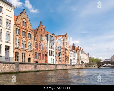 Facades of old and modern houses on Spiegelrei canal in old town of Bruges, Flanders, Belgium - Stock Photo