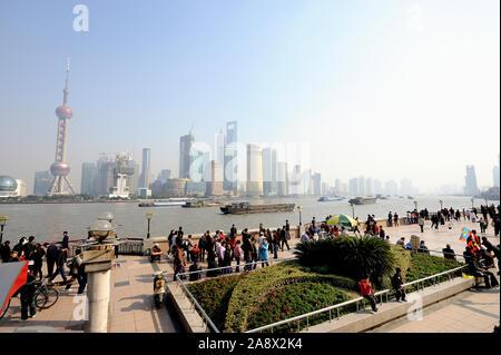 Shanghai,China-November 29,2018: Skyline of Pudong across Huangpu River from Bund Promenade in Shanghai, China - Stock Photo