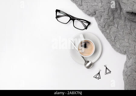 Coffee cup, sweater, lipsticks and glasses. Autumn or Winter feminine concept - Stock Photo