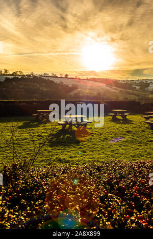 Sunset over some picnic tables in the glorious Derbyshire peak district national park, Empty tables on a frosty cold January evening at sunset - Stock Photo