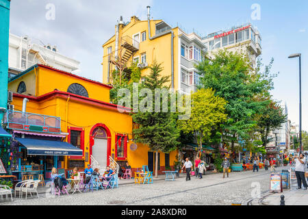 A street full of colorful shops and cafes in the historic Sultanahmet district of Istanbul, Turkey. - Stock Photo